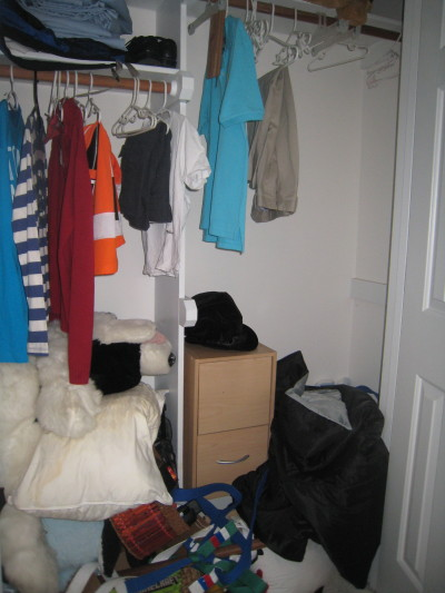 Boy's closet before in home for sale.